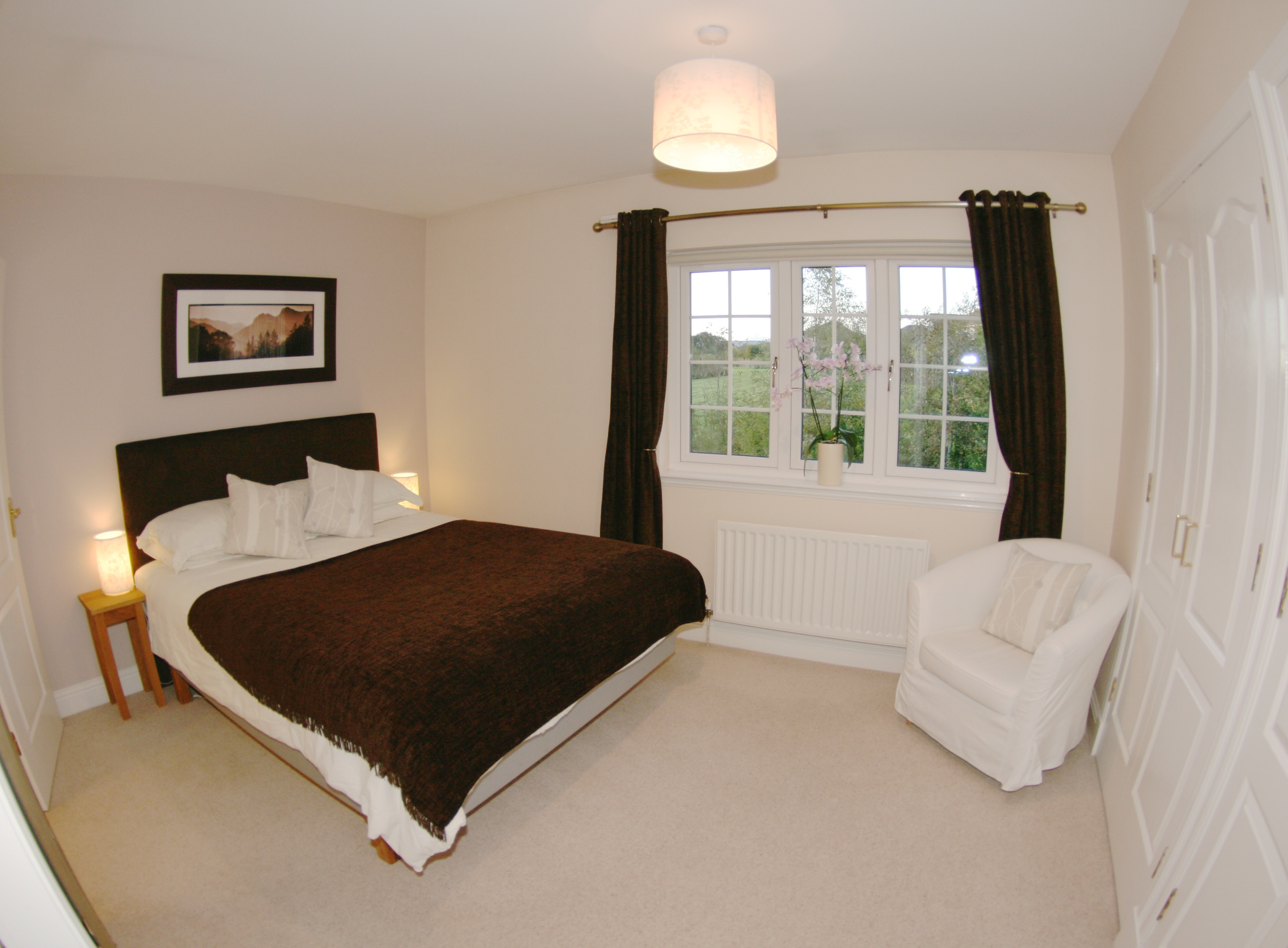 double bedroom with curtains drawn