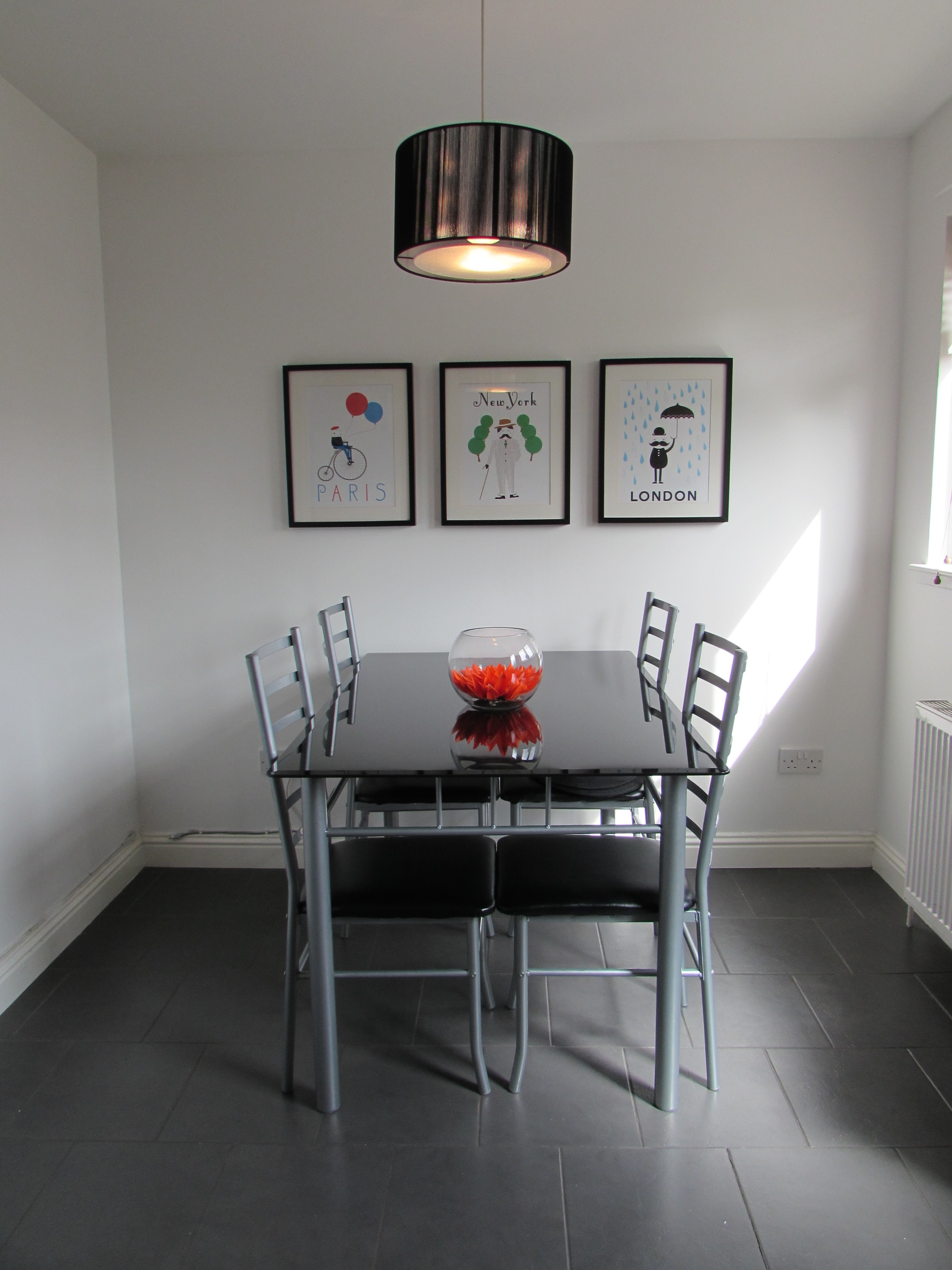 silver and black metal dining table